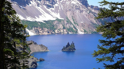 This island is called the Phantom Ship. It is the remains of a 400,000 year old lava flow that was covered by the volcano that formed Crater Lake. When Crater Lake was fomed, 8,000 years ago ...
